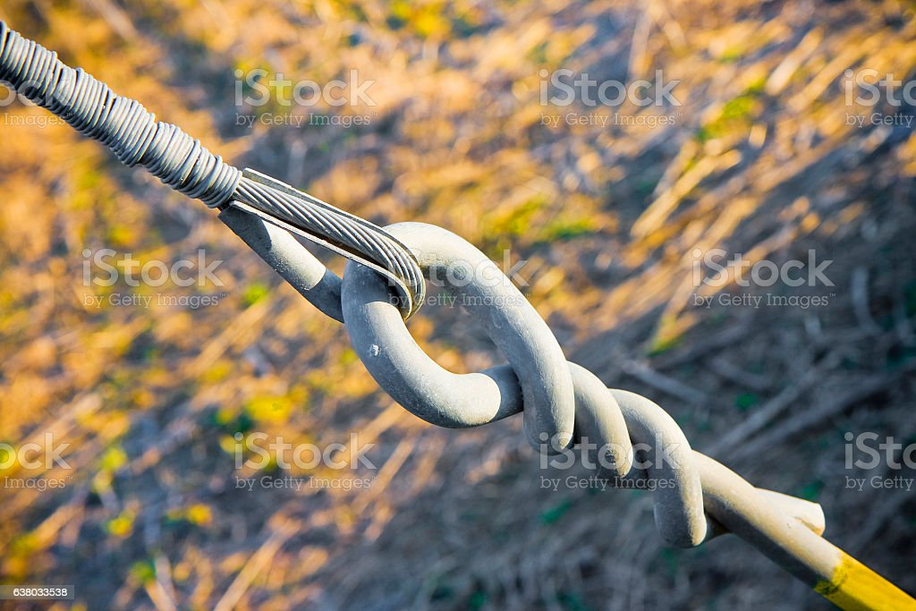 Iron tie rod with steel cable - concept image stock photo