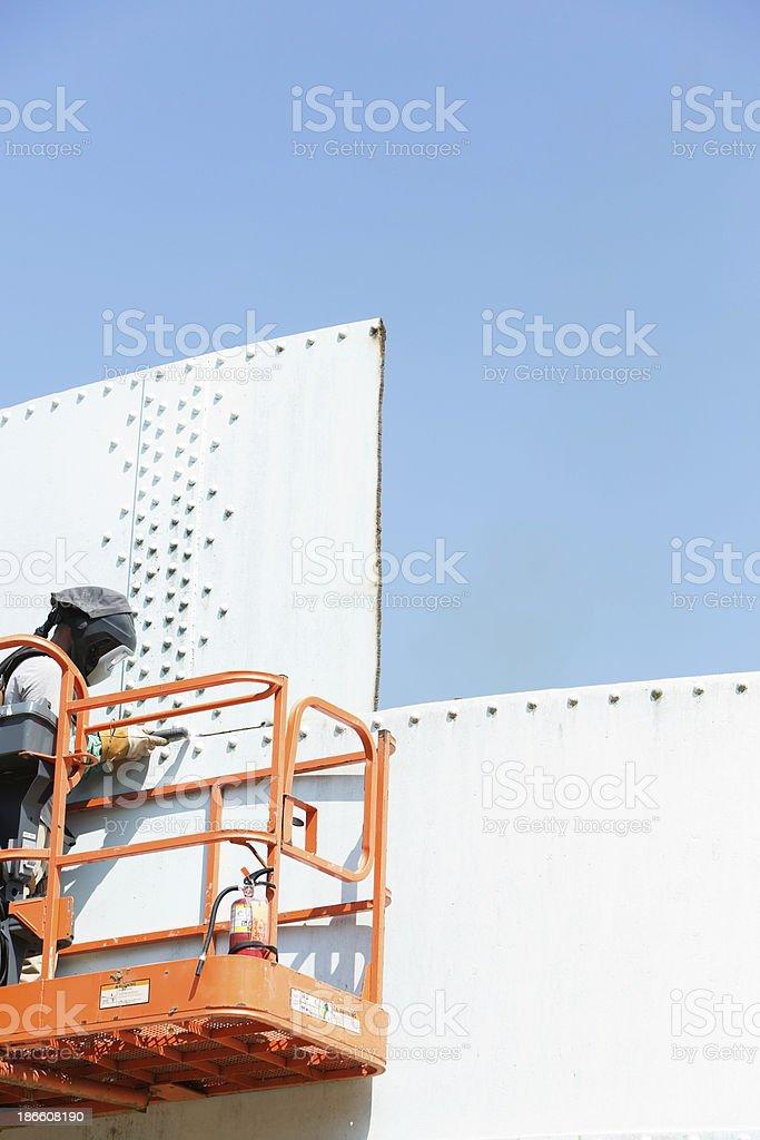 Iron Worker using Plasma Cutter stock photo