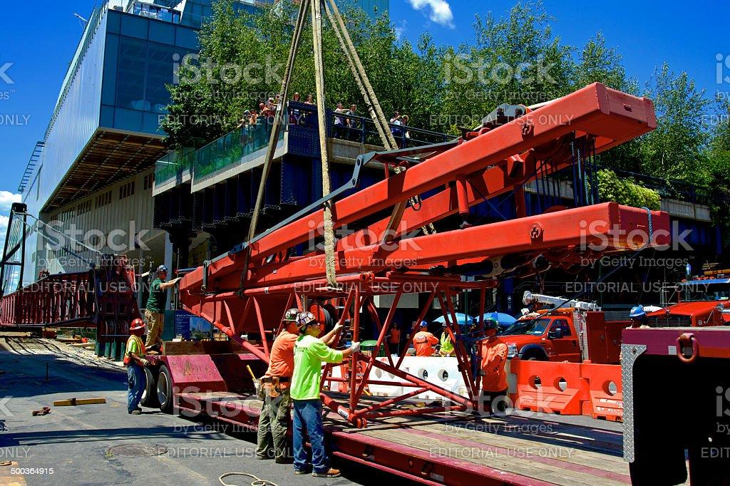 Iron Workers Union Members Disassembling Crane, Manhattan, New York City stock photo