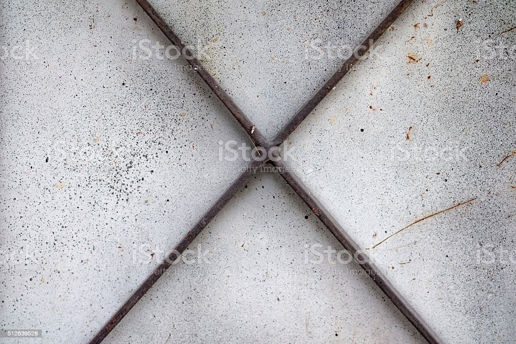 Iron X shape on a background stock photo
