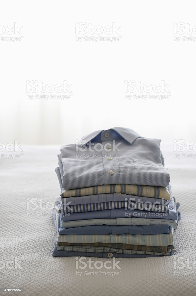 Ironed And Folded Shirts On Bed royalty-free stock photo