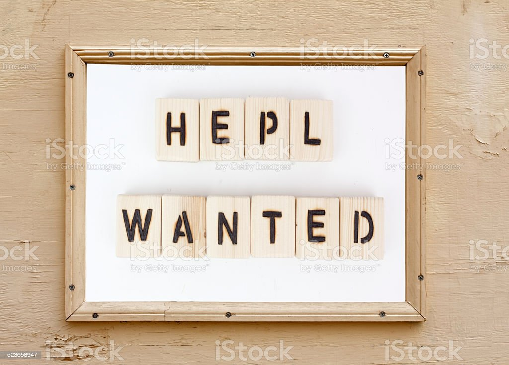 Ironic HELP WANTED Sign stock photo