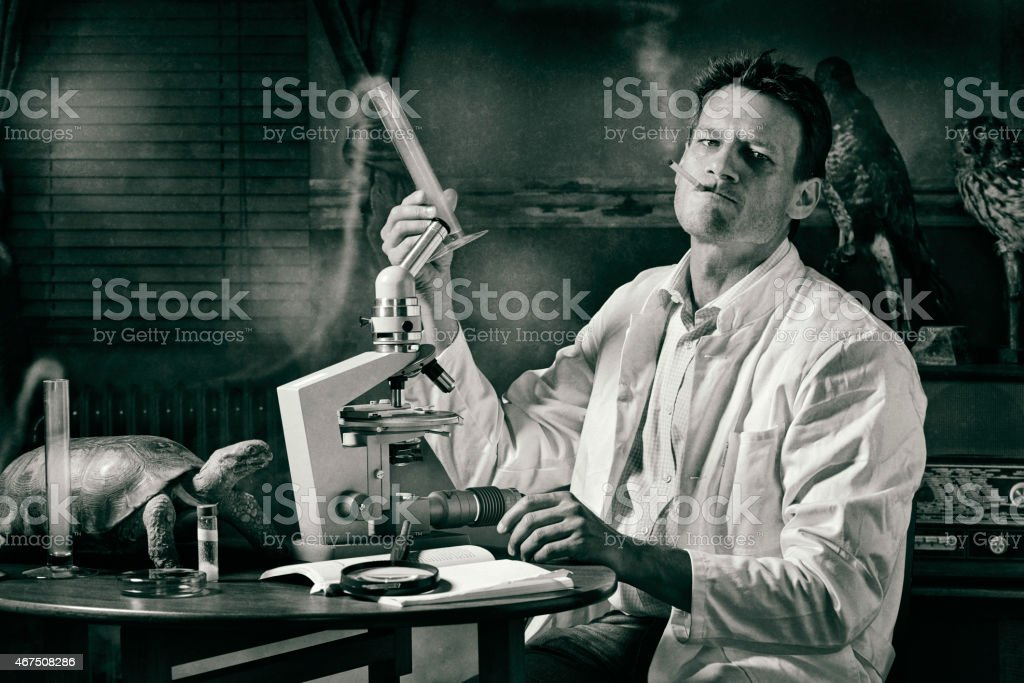 Ironical image of smoking scientist researching stock photo