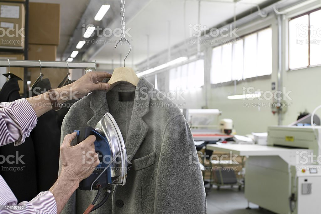 Ironing A Garment High Fashion.Color Image royalty-free stock photo