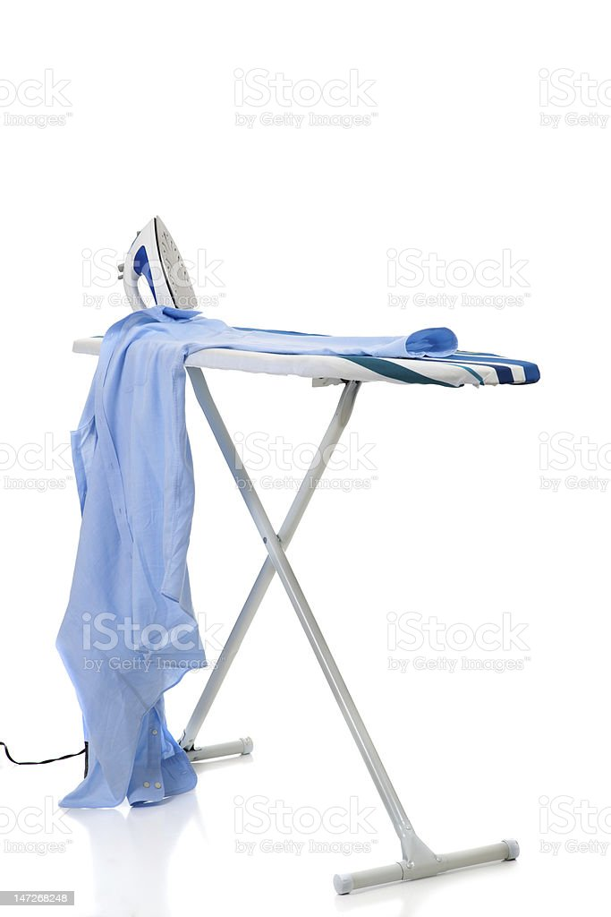 Ironing Board with shirt and Iron stock photo