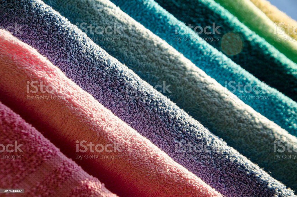 Ironing colorful towels stock photo