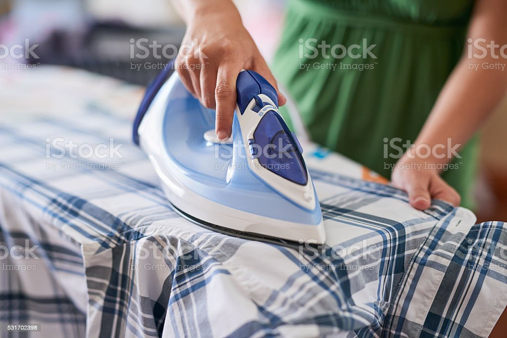 Ironing out the wrinkles stock photo