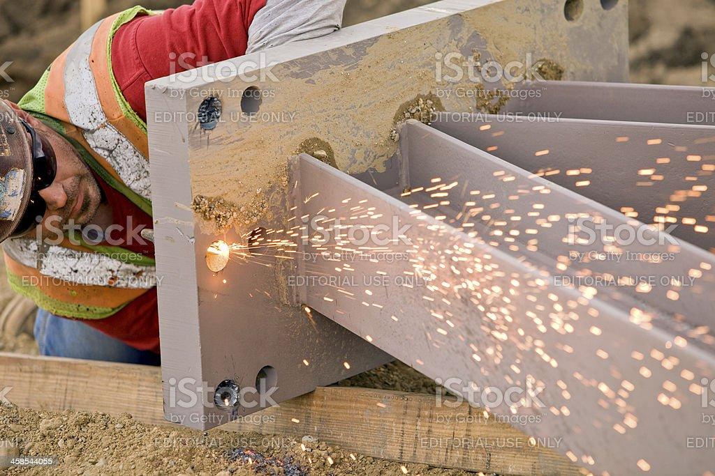 Ironworker Using a Cutting Torch on Steel Pillar stock photo