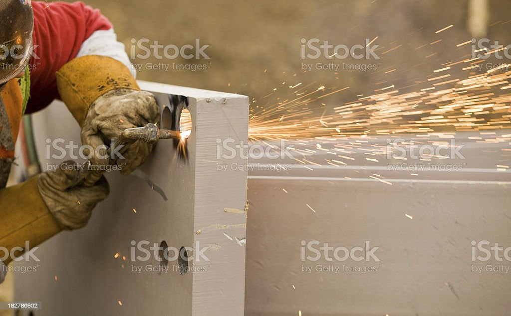 Ironworker using a Cutting Torch on Support Column stock photo