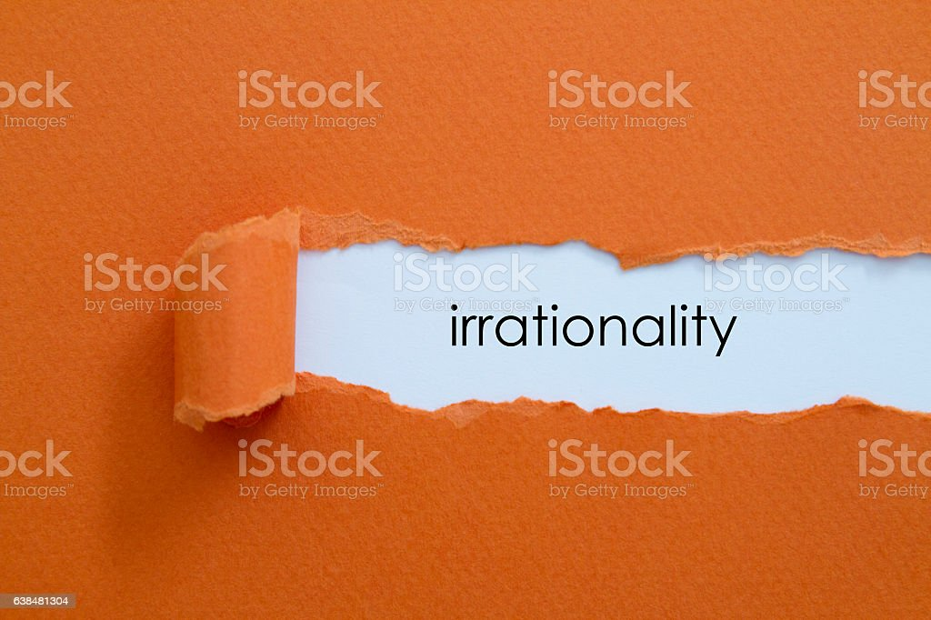 Irrationality word written under torn paper. stock photo