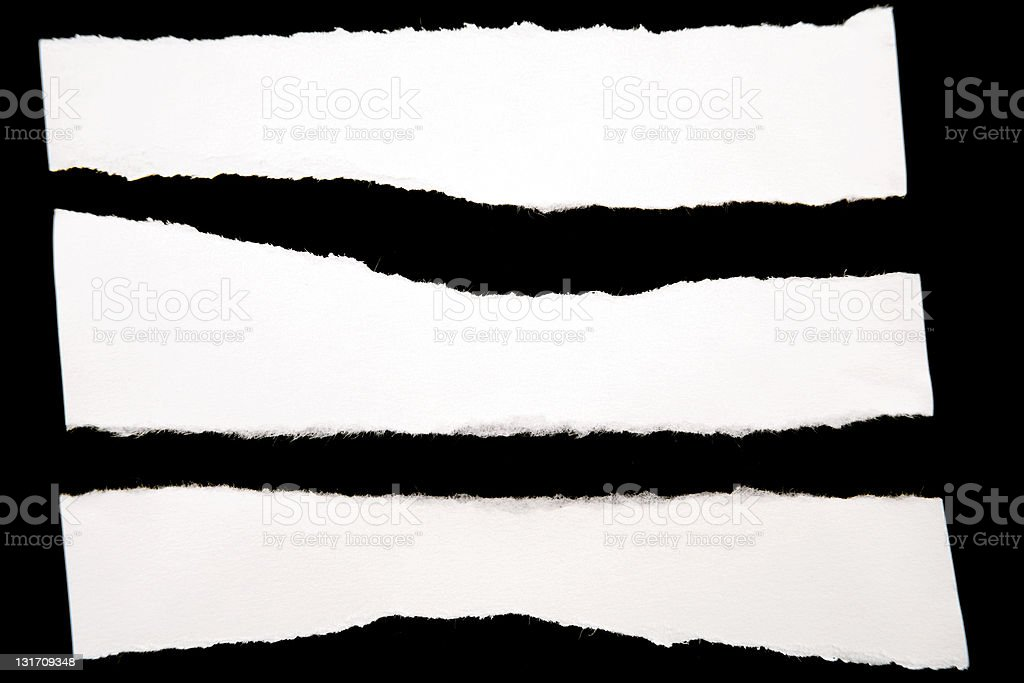 Irregular paper pieces on black background royalty-free stock photo