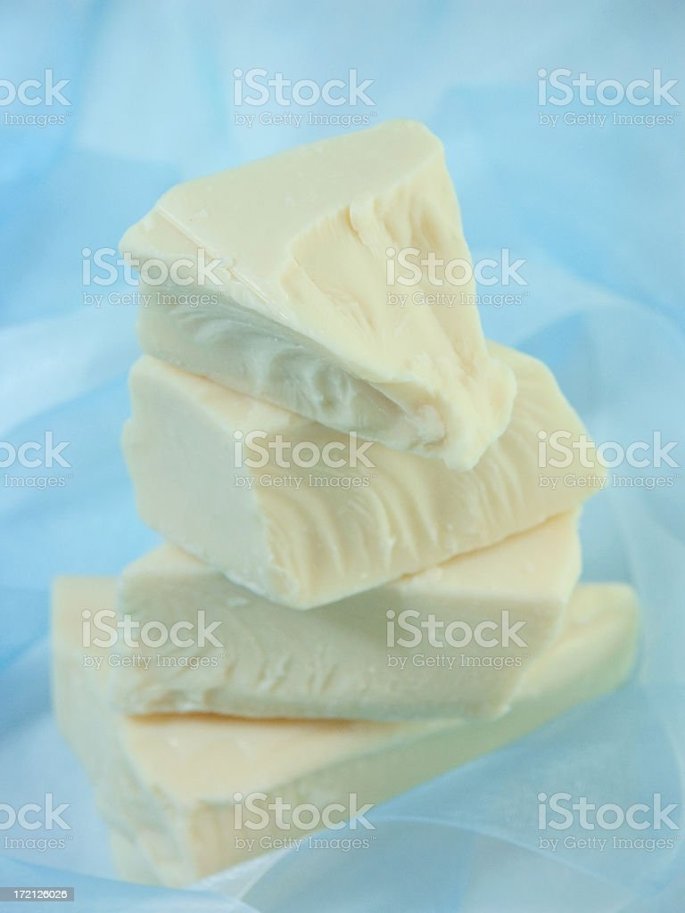 Irregular pieces of white chocolate stock photo