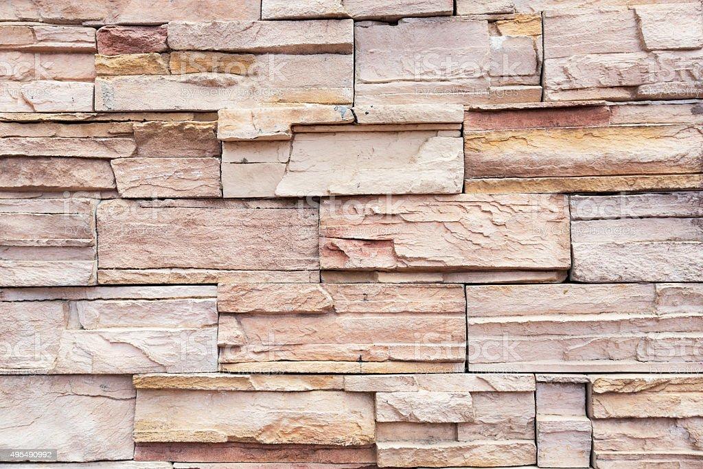 Irregularly shaped brick wall texture background stock photo