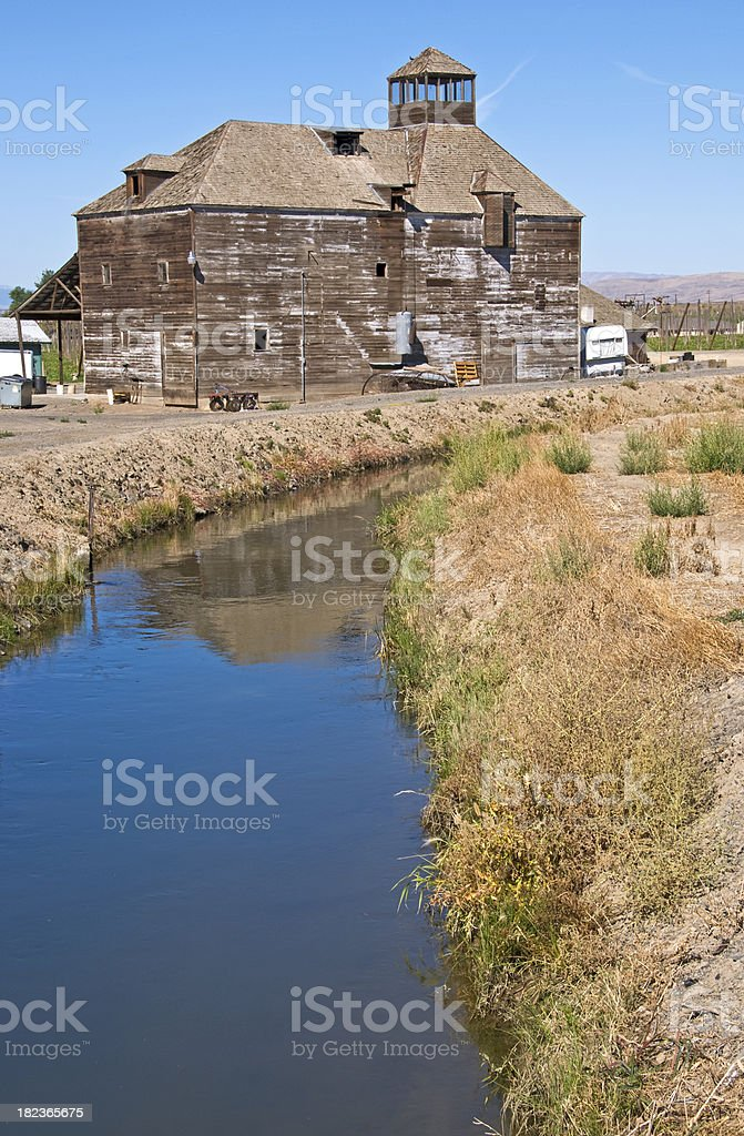 Irrigation canal and barn in Yakima Valley stock photo