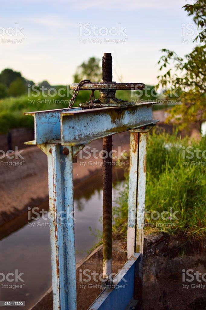 Irrigation channel floodgate / Compuerta del canal de riego stock photo