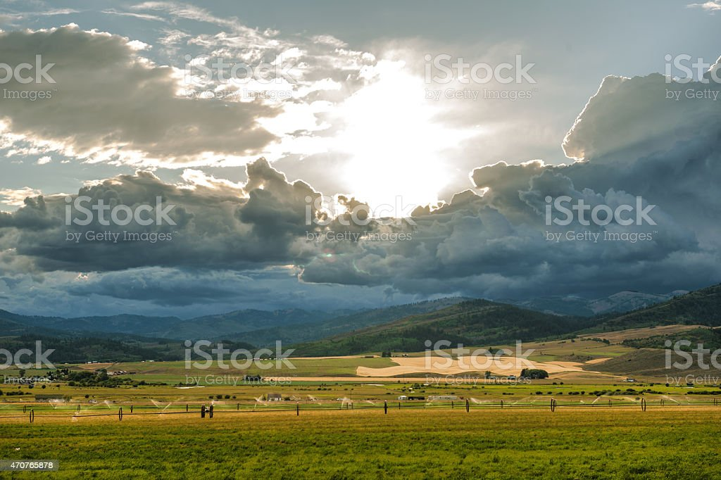 Irrigation farmers fields before the storm by Road 16 Wyoming stock photo