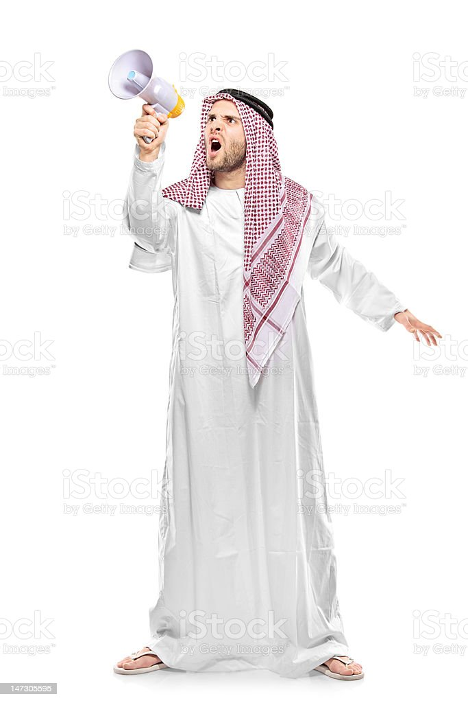 Irritated arab person screaming on a megaphone royalty-free stock photo