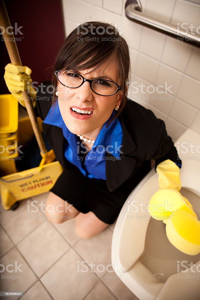 Irritated Business Woman Cleaning the Restroom Toilet royalty-free stock photo