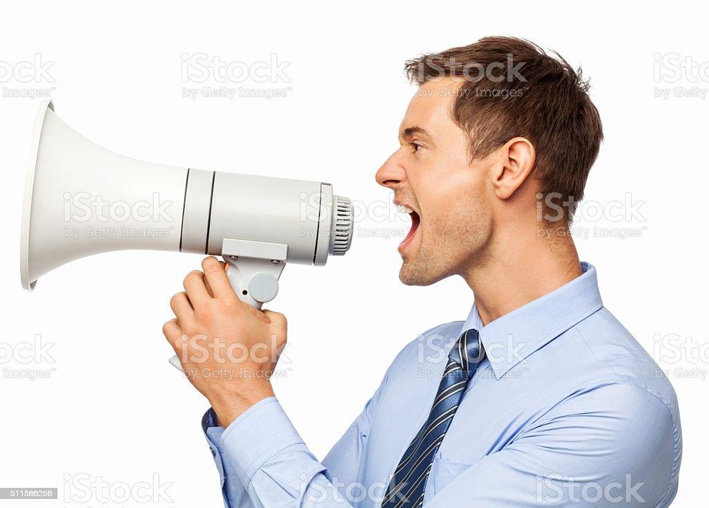 Irritated Businessman Shouting Through Megaphone stock photo