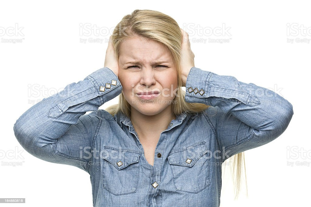 Irritated Girl Covers Ears stock photo