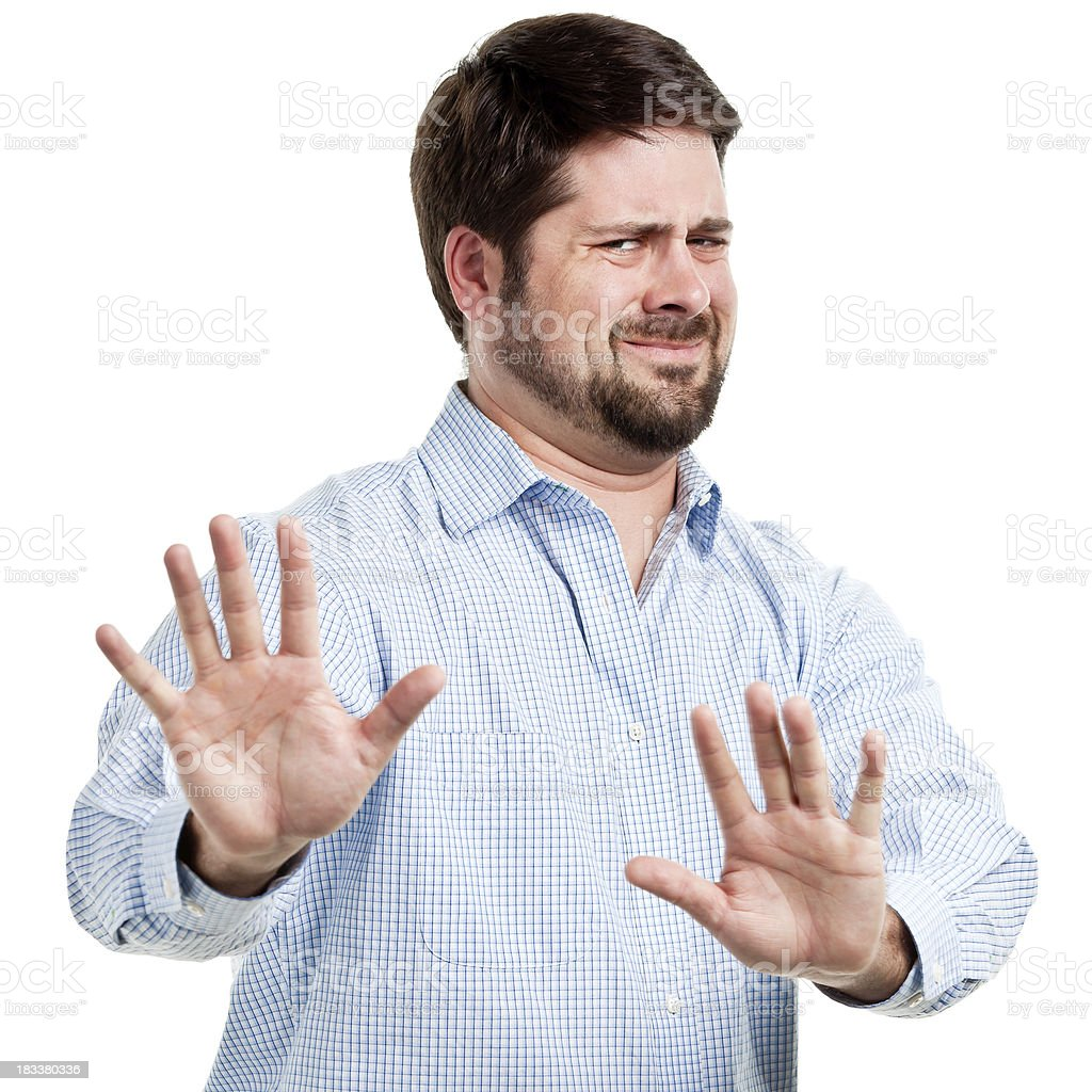 Irritated Man With Hands Out In Stop Gesture stock photo