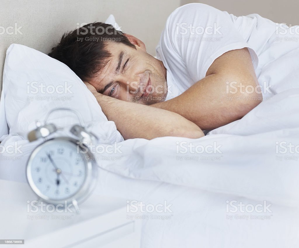 Irritated man woken up in the morning royalty-free stock photo