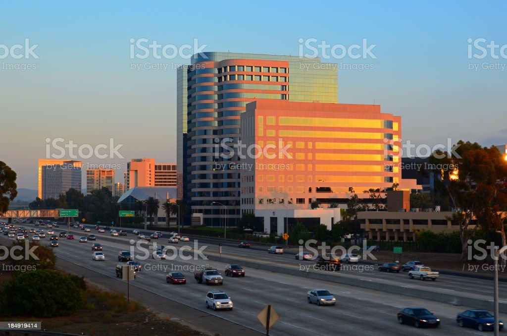 Irvine city skyline and freeway at sunset stock photo