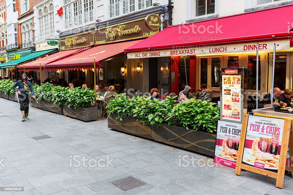 Irving street with restaurants in London, UK stock photo