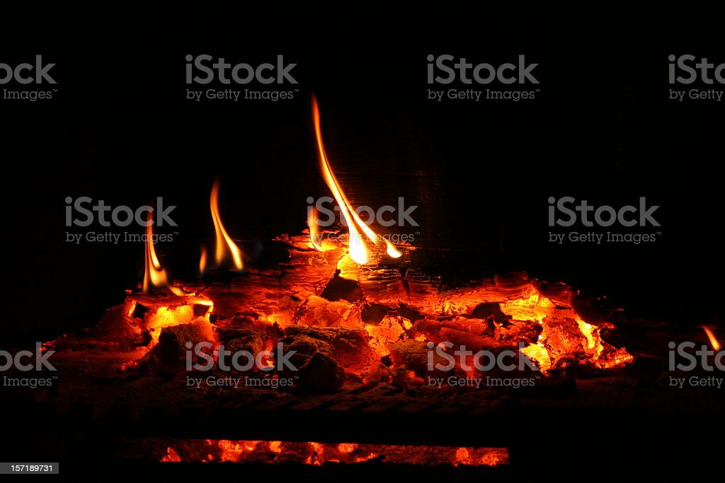 Is good to warm my bones besides the fire stock photo