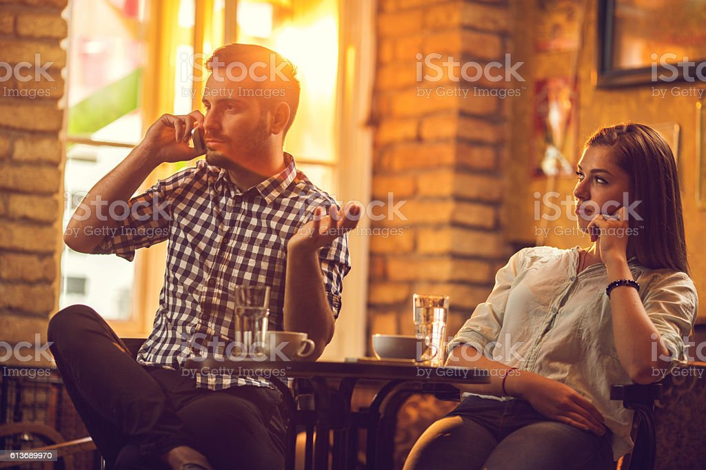 Is he ever going to finish phone call? stock photo