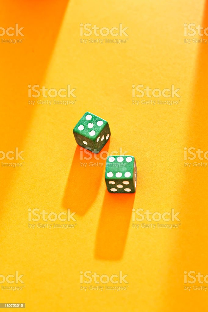 Is life a game of chance? Dice on golden background royalty-free stock photo