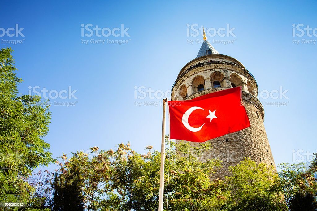 Isanbul Turkey Galata tower with Turkish flag clear sky stock photo