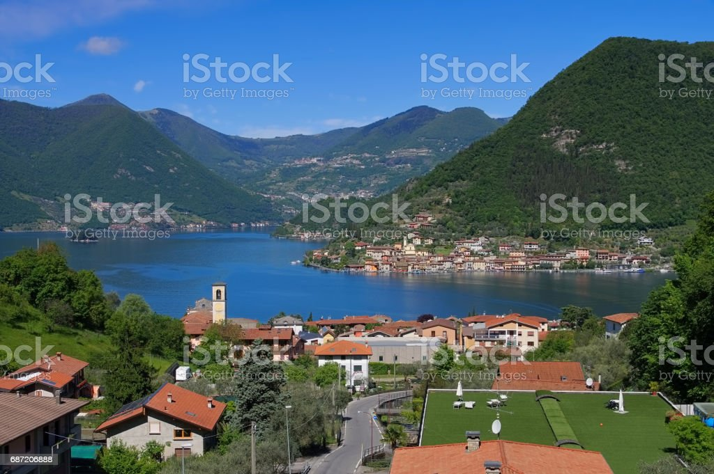 Iseo lake and island Monte Isola in Alps, Lombardy in northern Italy stock photo