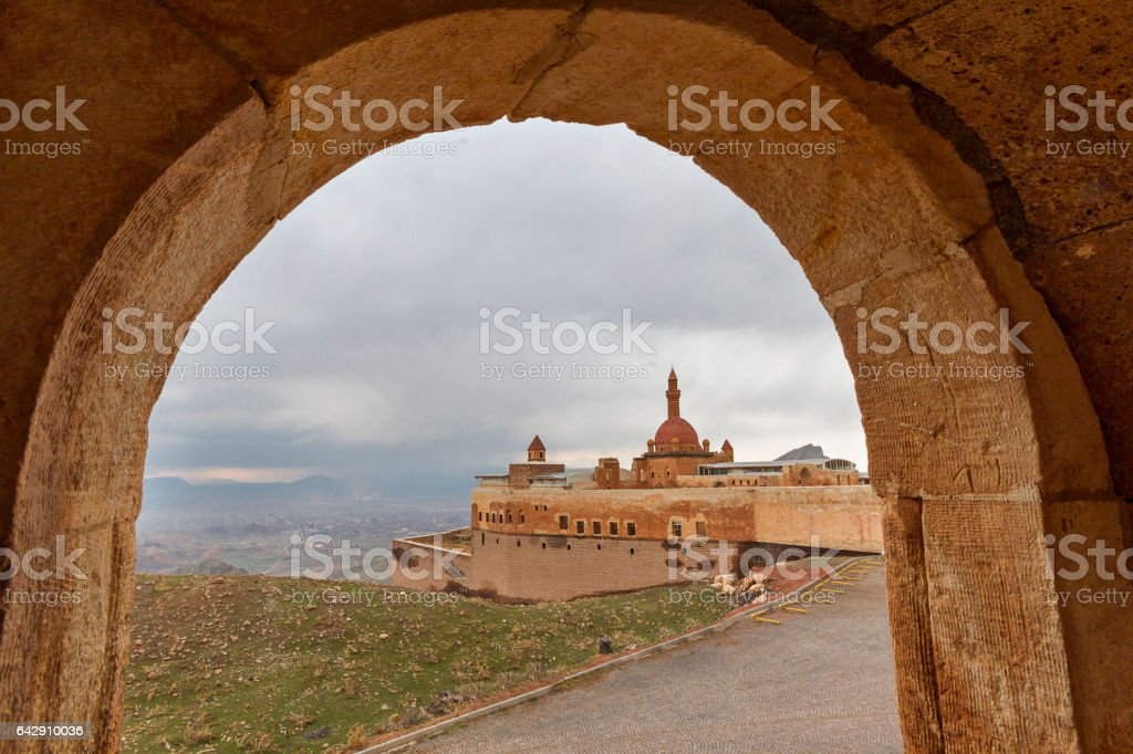 Ishak Pasha Palace through the arch, Dogubayazit, Turkey. stock photo