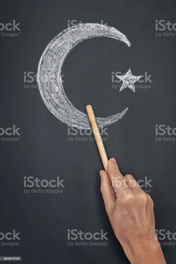islam symbol on blackboard stock photo