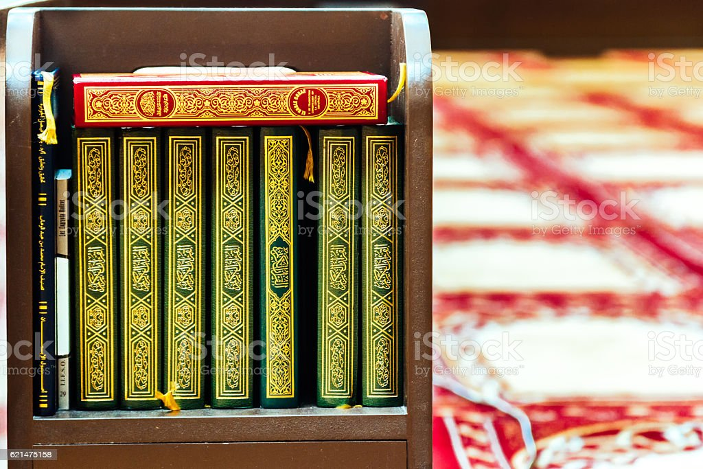 Islamic and Koran books in a prayer room in mosque stock photo