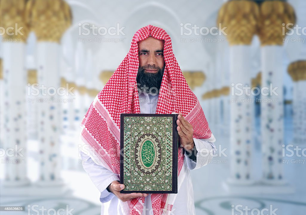 Islamic Arabian Shiekh presenting Quran stock photo