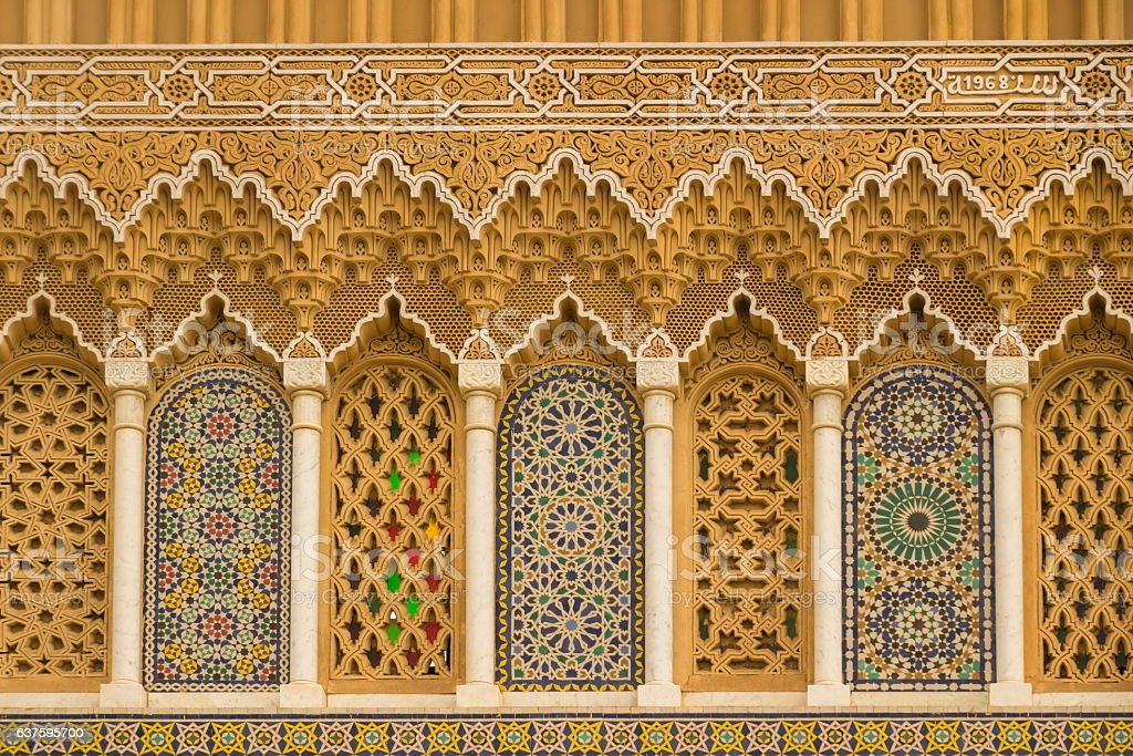 Islamic calligraphy and colorful geometric patterns a Morocco. stock photo