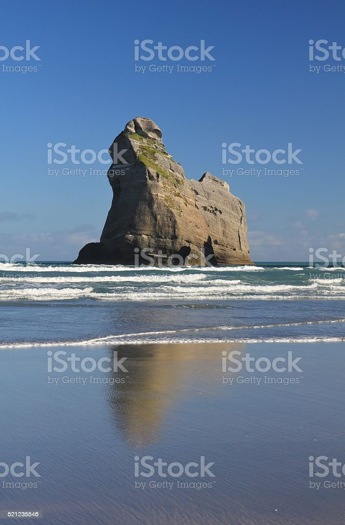 Island at Wharariki Beach, New Zealand stock photo