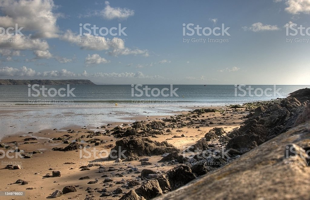 Island beach from rocky shore royalty-free stock photo
