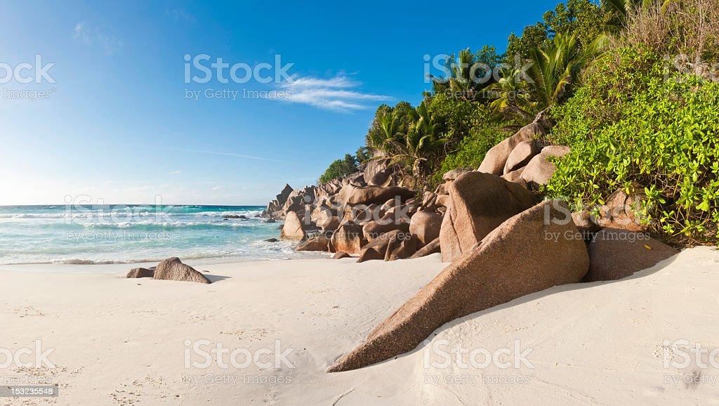 Island beach paradise golden sand white surf turquoise ocean Seychelles royalty-free stock photo