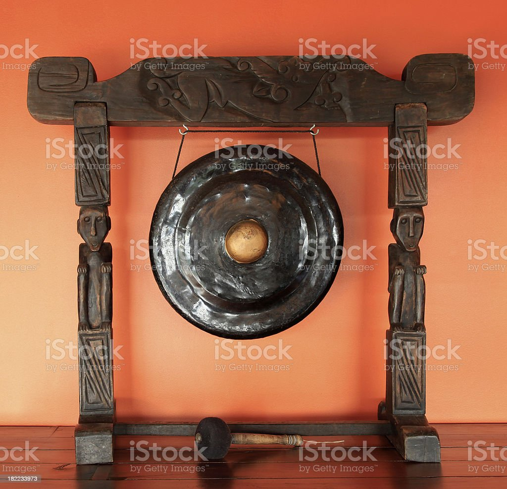 Island Ceremonial Gong. Tribal Artifact on orange background royalty-free stock photo