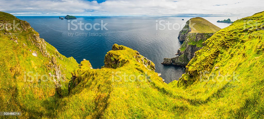 Island cliffs wild blue ocean rocky shore St Kilda Scotland stock photo