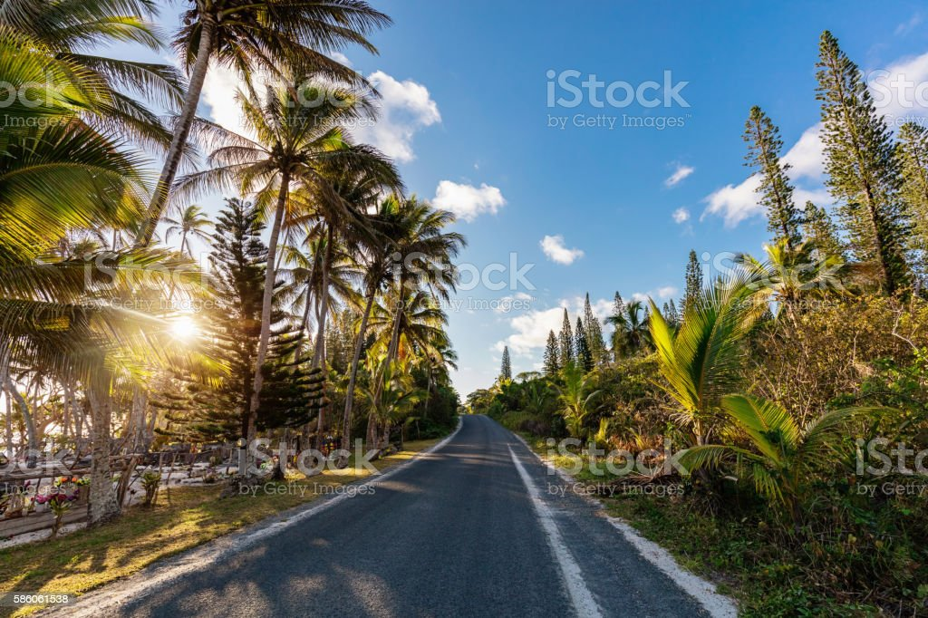 Island Country Road into Sunset New Caledonia stock photo