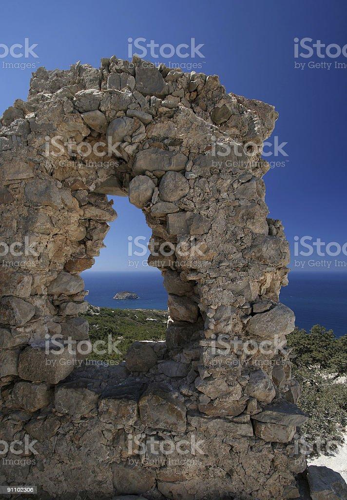 Island in a window on Monolithos royalty-free stock photo