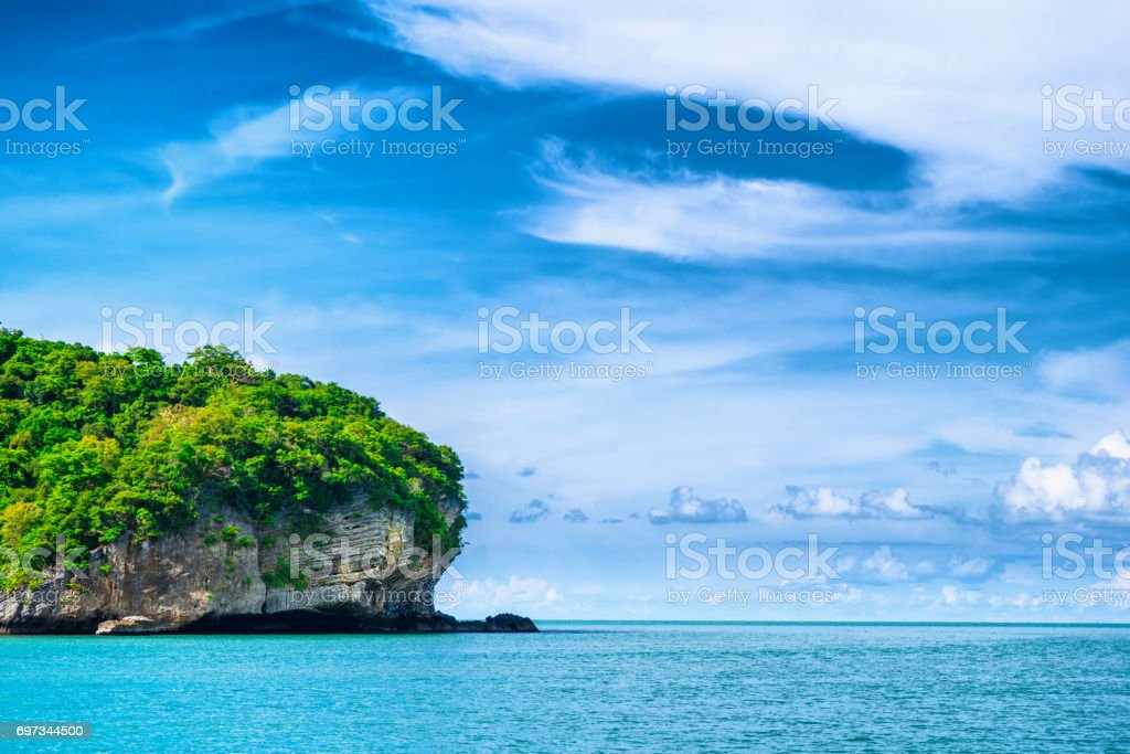 Island in thailand gulf with dramatic blue sky stock photo