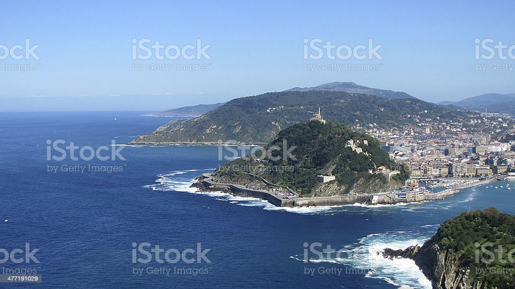 Island in the sea San Sebastian harbor royalty-free stock photo