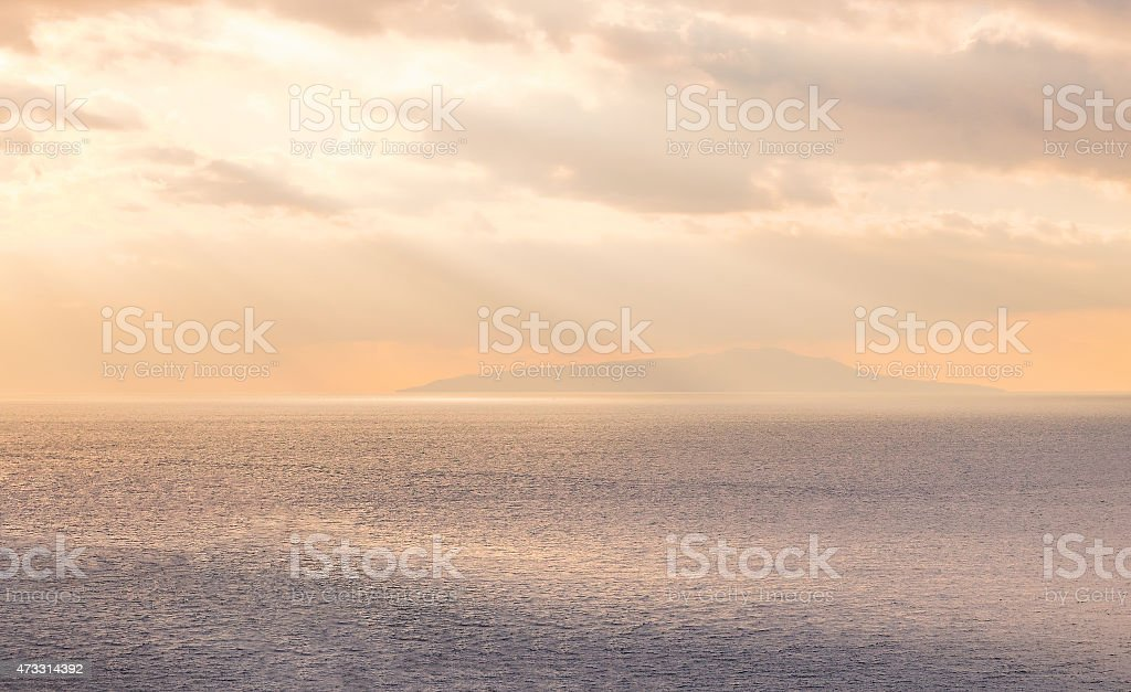 Island over the sea in dawn stock photo