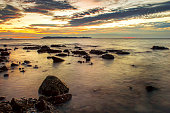 Island sea rock beach with twilight sunset sky landscape