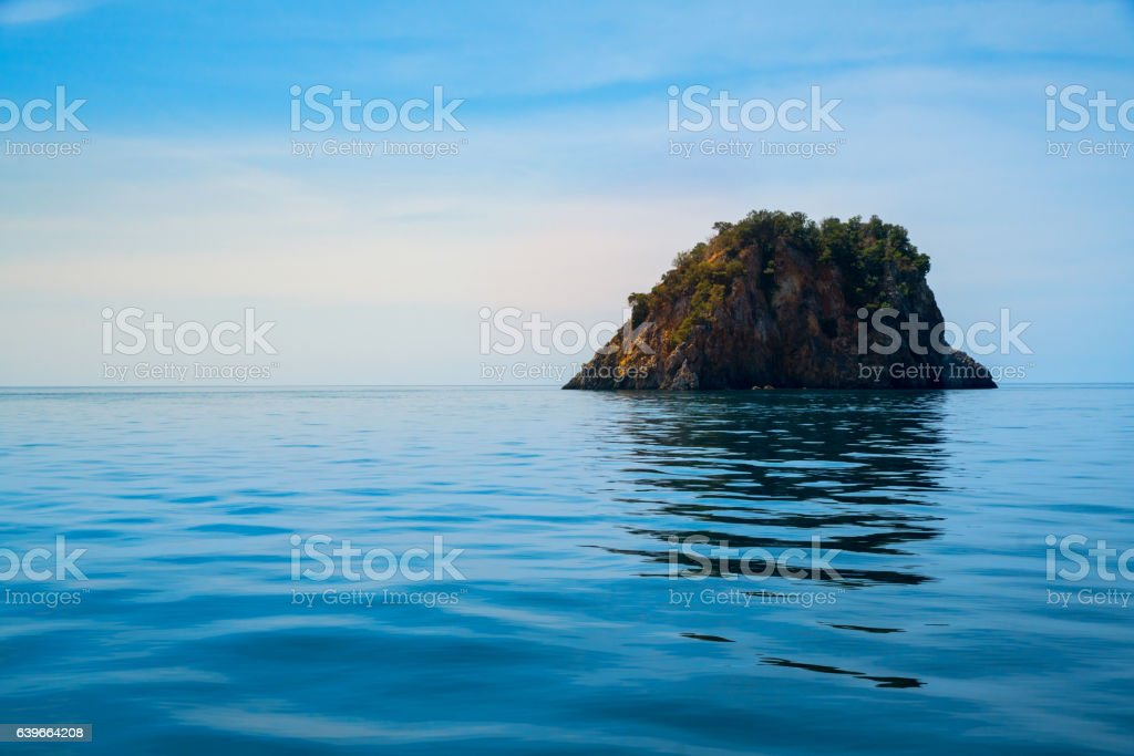 Island stand-alone on tranquil wave over sea stock photo